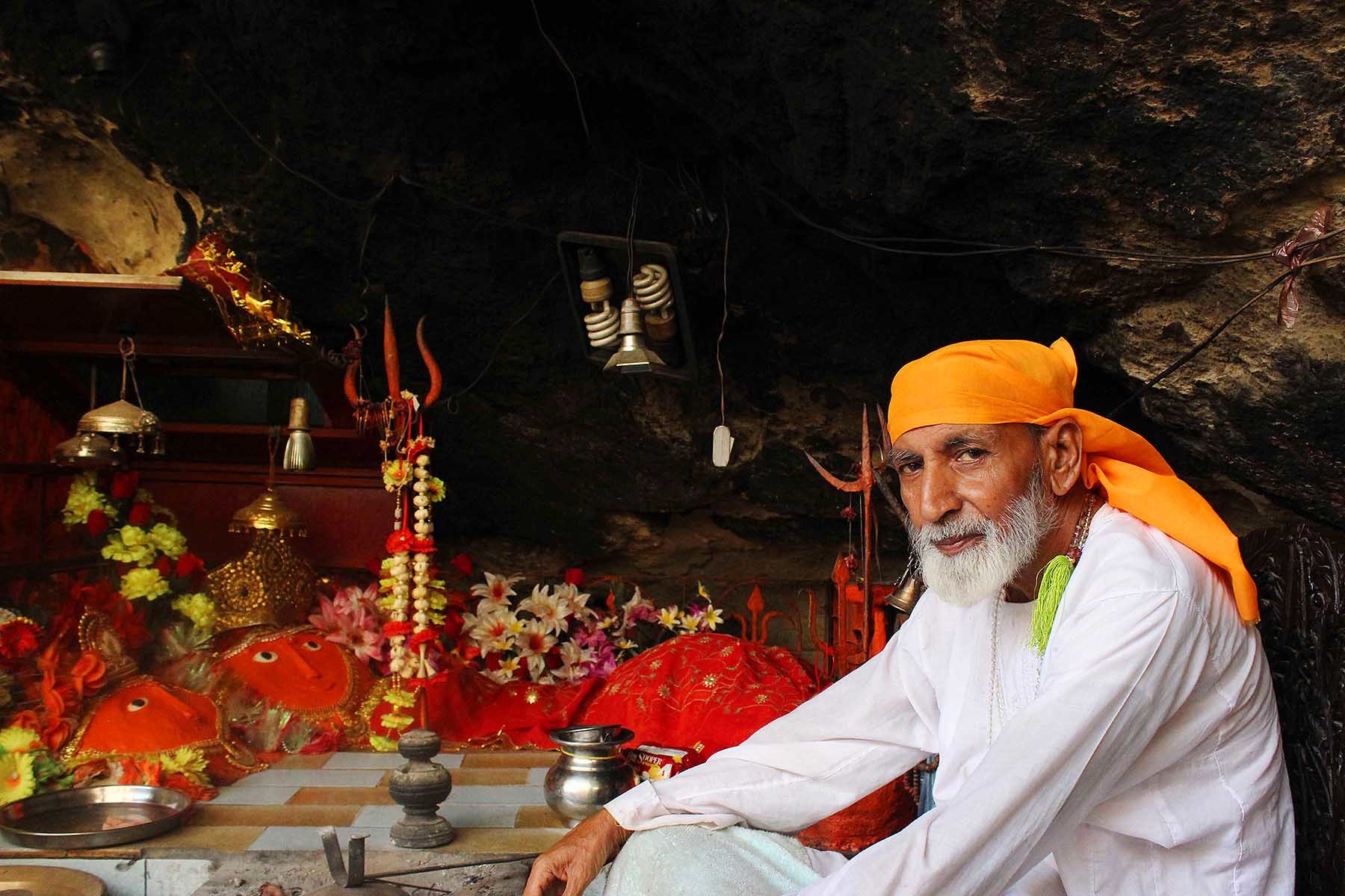 Gopal Gree sitting with the statue of Hinglaj Mata and her friend.