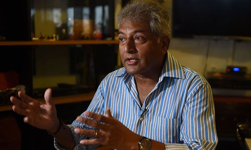 In this photograph taken on August 22, 2015, Pakistani management professor and former rock-band musician Leon Menezes speaks during an interview with AFP in Karachi.
