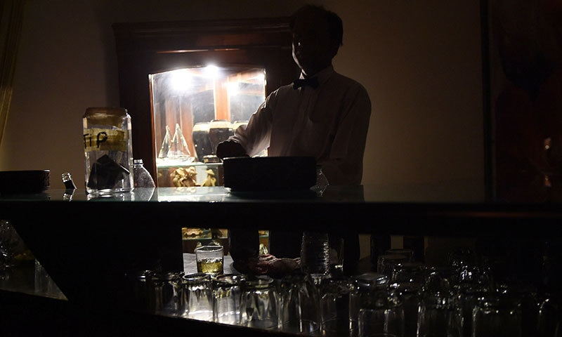 In this photograph taken on August 21, 2015, a bar-tender prepares drinks at a club in Karachi. - AFP