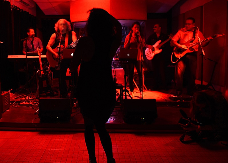 In this photograph taken on August 21, 2015, an owner of private nightclub performs with other musicians in Karachi. —AFP