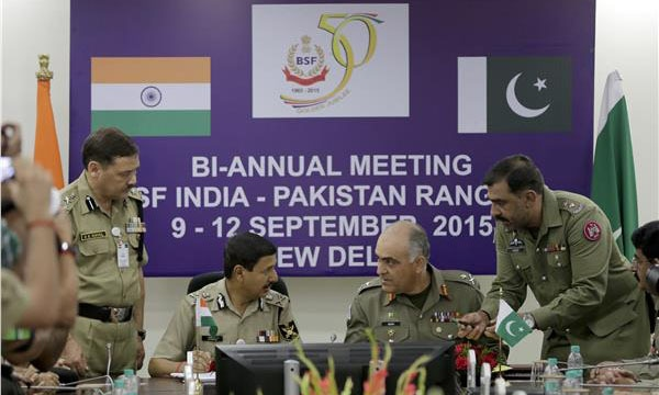 Indian Border Security Force (BSF) Director General D.K. Pathak (L) and Pakistan Rangers DG Major General Umar Farooq Burki speak to each other during signing of a joint accord in New Delhi on Saturday. - AP