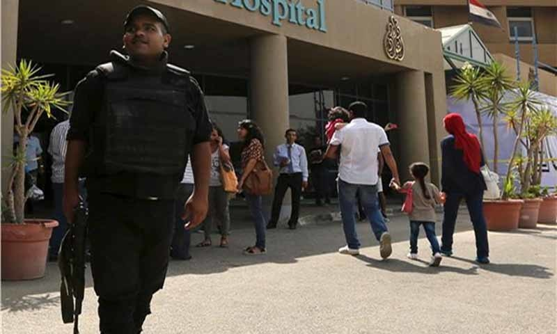 An Egyptian police officer stands guard outside Dar Al Fouad Hospital, where injured tourists who were mistakenly targeted in a military operation are recovering. — Reuters