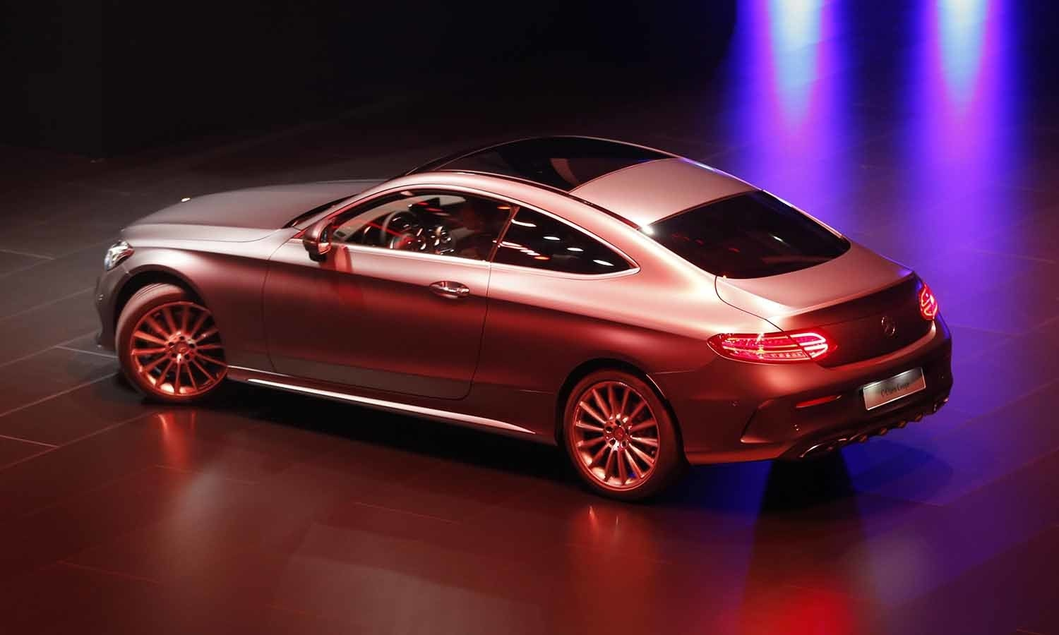 A Mercedes C-Class Coupe is presented on the first press day of the Frankfurt Auto Show (IAA). ─ AP