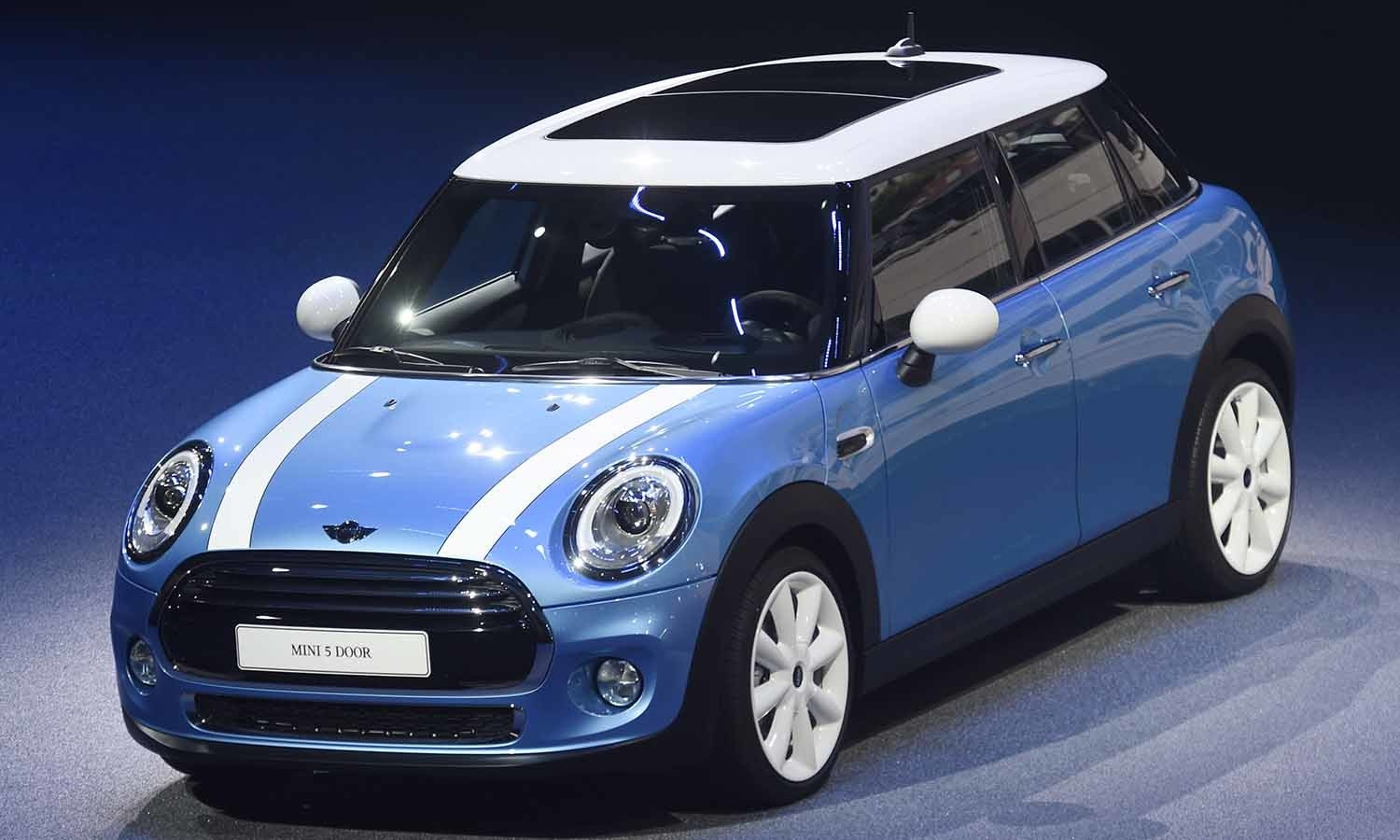 A Mini 5 door is displayed during the BMW presentation on the first press day of the show. ─ AP