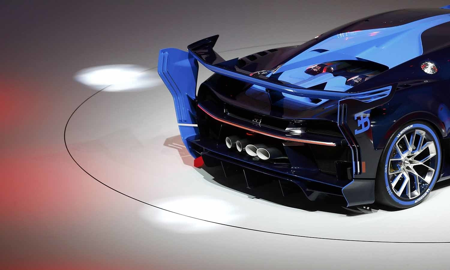 A back view of the Bugatti Vision concept car is presented during the Volkswagen group night. ─ Reuters