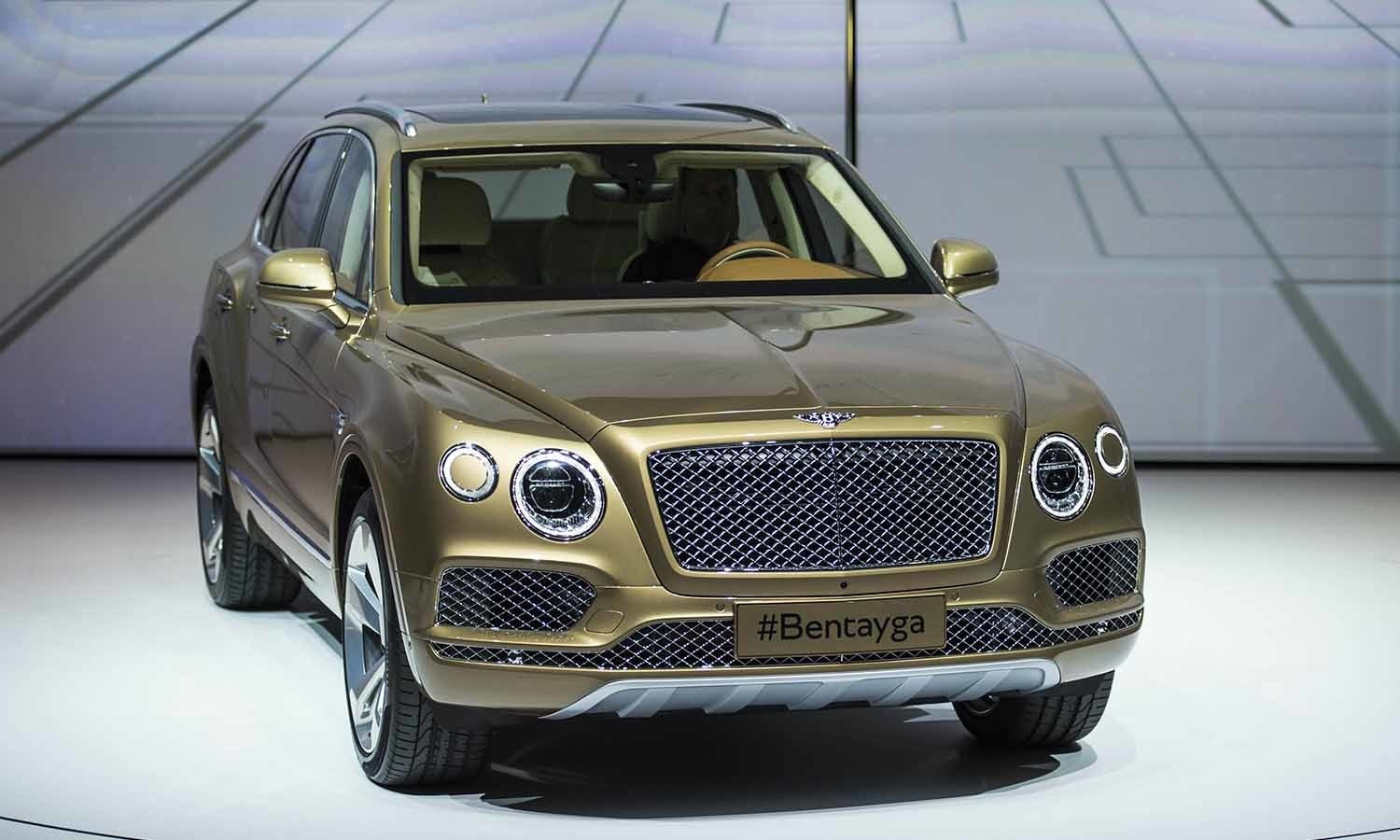 The luxury SUV Bentley Bentayga car is presented during the Volkswagen group night. ─ AFP