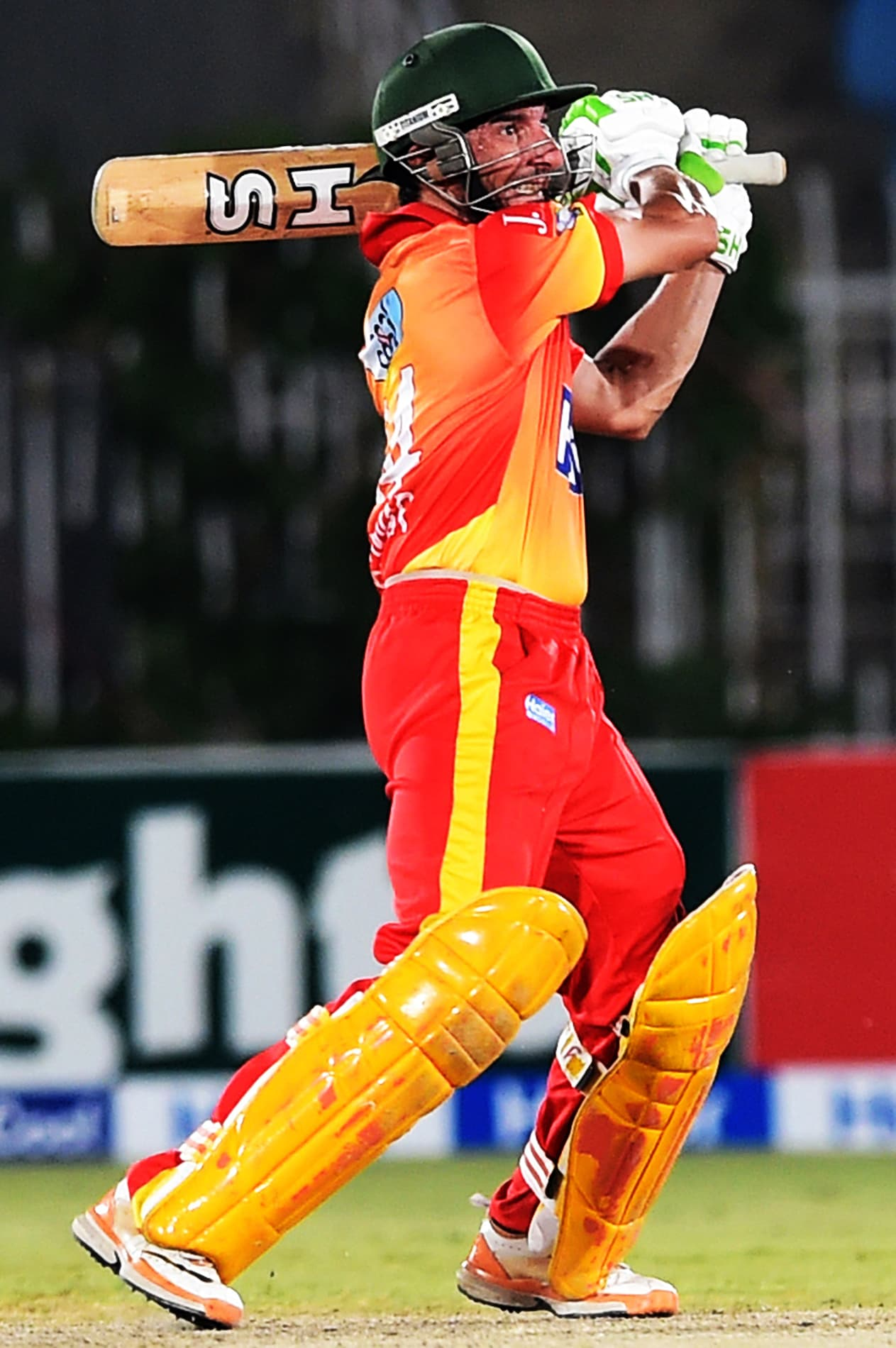 This photo taken on September 14, 2015 shows Peshawar cricket team opener Raffatullah Mohmand batting against Sialkot during the National T20 semi-final at the Rawalpindi Cricket Stadium in Rawalpindi. — AFP
