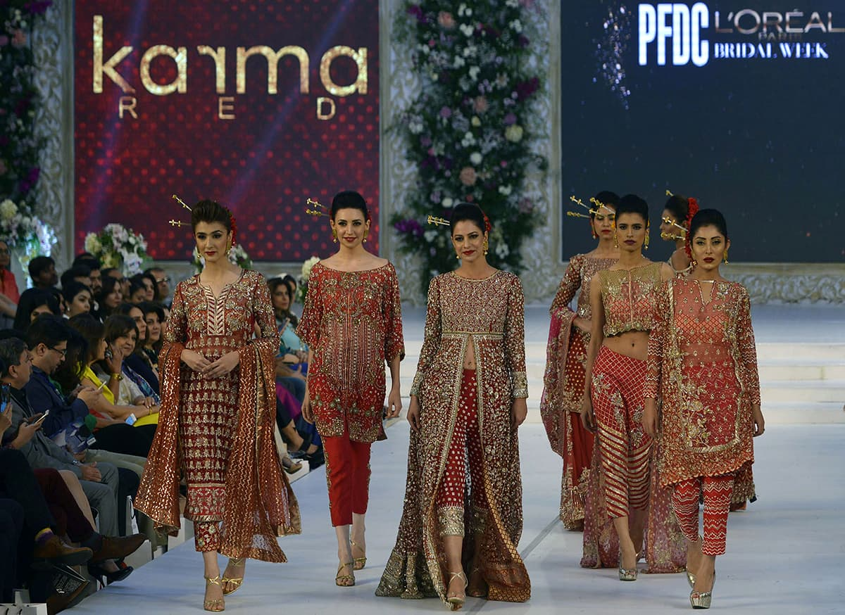 Models present creations by Pakistani designer Karma Red on the first day of the Pakistan Fashion Design Council (PFDC) L'Oreal Paris Bridal Week in Lahore—AFP