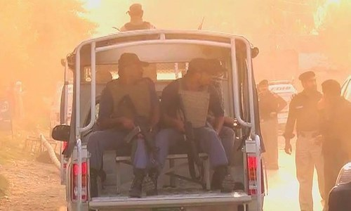Security forces at the scene of the attack. ─ DawnNews screengrab.