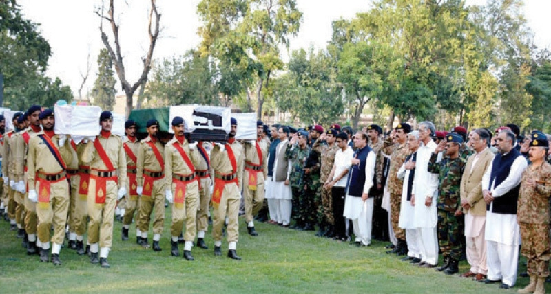 Prime Minister Nawaz Sharif and army and civilian leaders pay their respects to the victims of Badhaber base camp attack in Peshawar on Friday. —APP