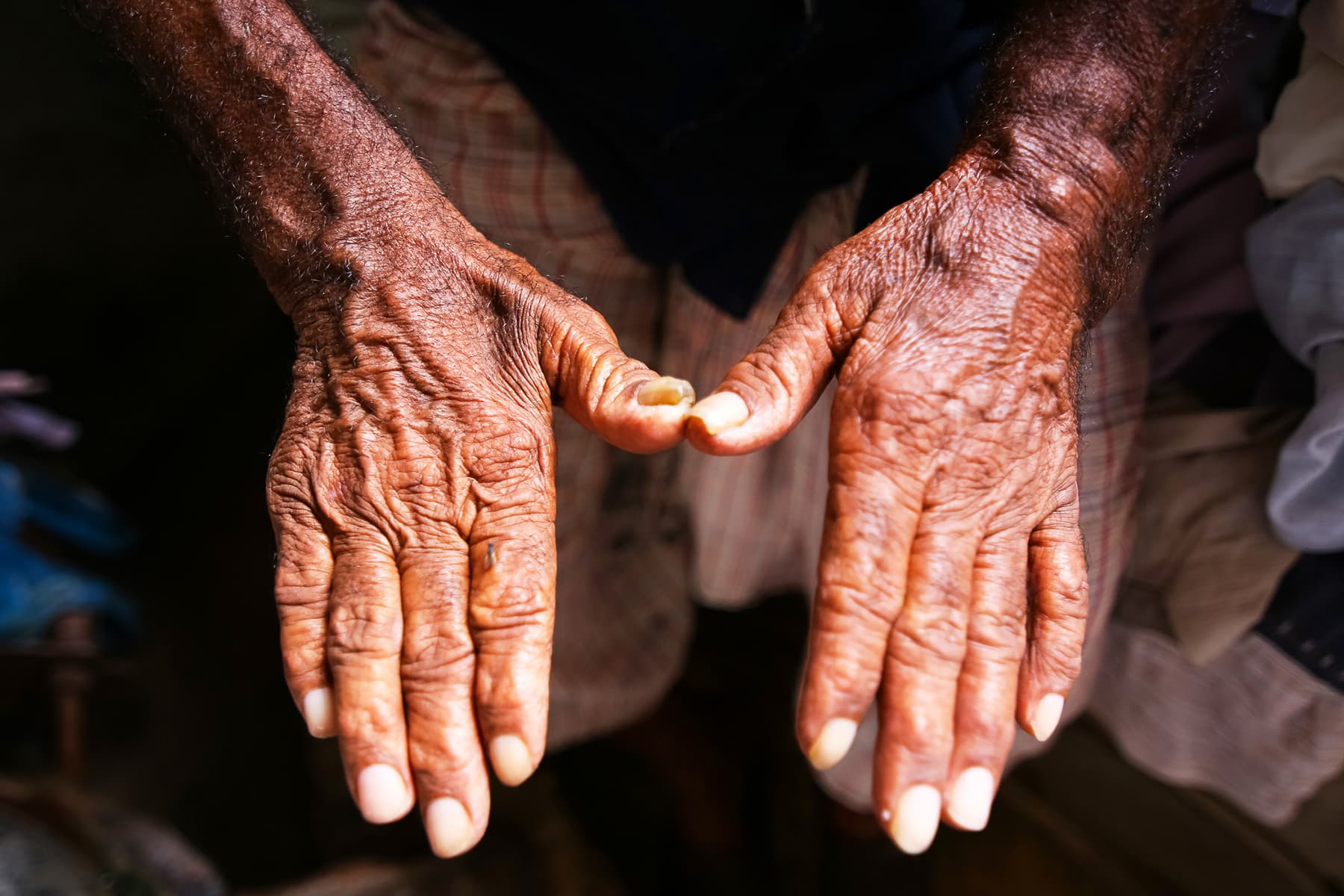 Mohmmad Hanif's hands after over a half-century's worth of work.