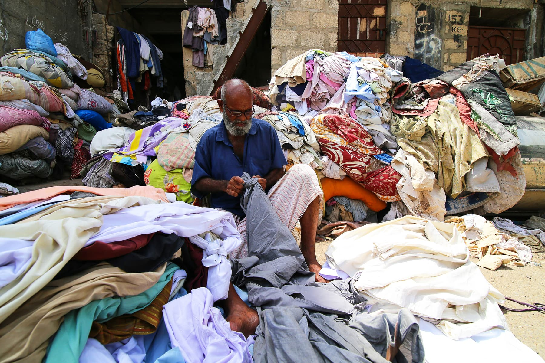 Hanif sorting dirty clothes.