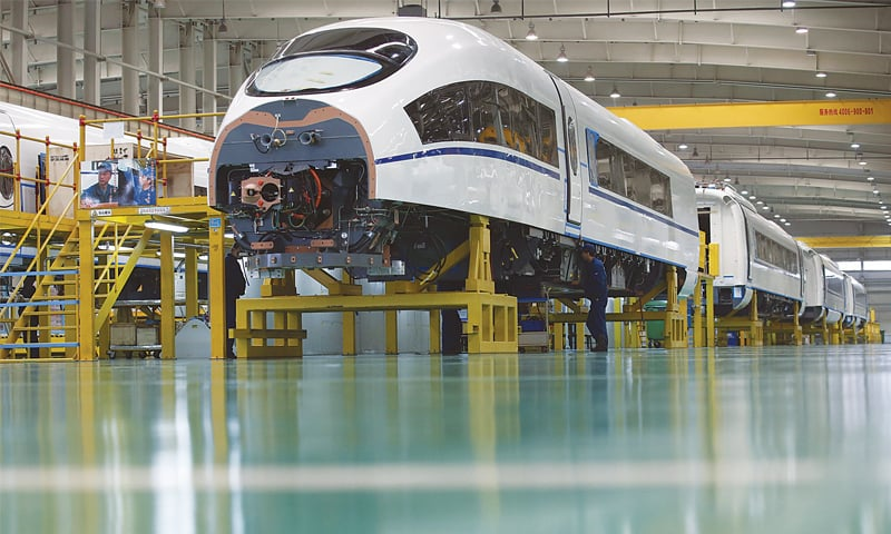 An employee works at an assembly line of China CNR in Tangshan, Hebei province, in this file photo. A unit of China's CRRC Corp, the world's biggest train-maker by revenue, last week broke ground on a factory in the US which will manufacture trains for Boston's subway system as part of a $556m deal that the unit won a year ago.—Reuters