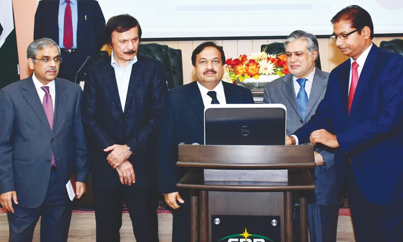 Finance Minister Ishaq Dar performing the balloting for the selection of cases for tax audit at the FBR office in Islamabad last week.