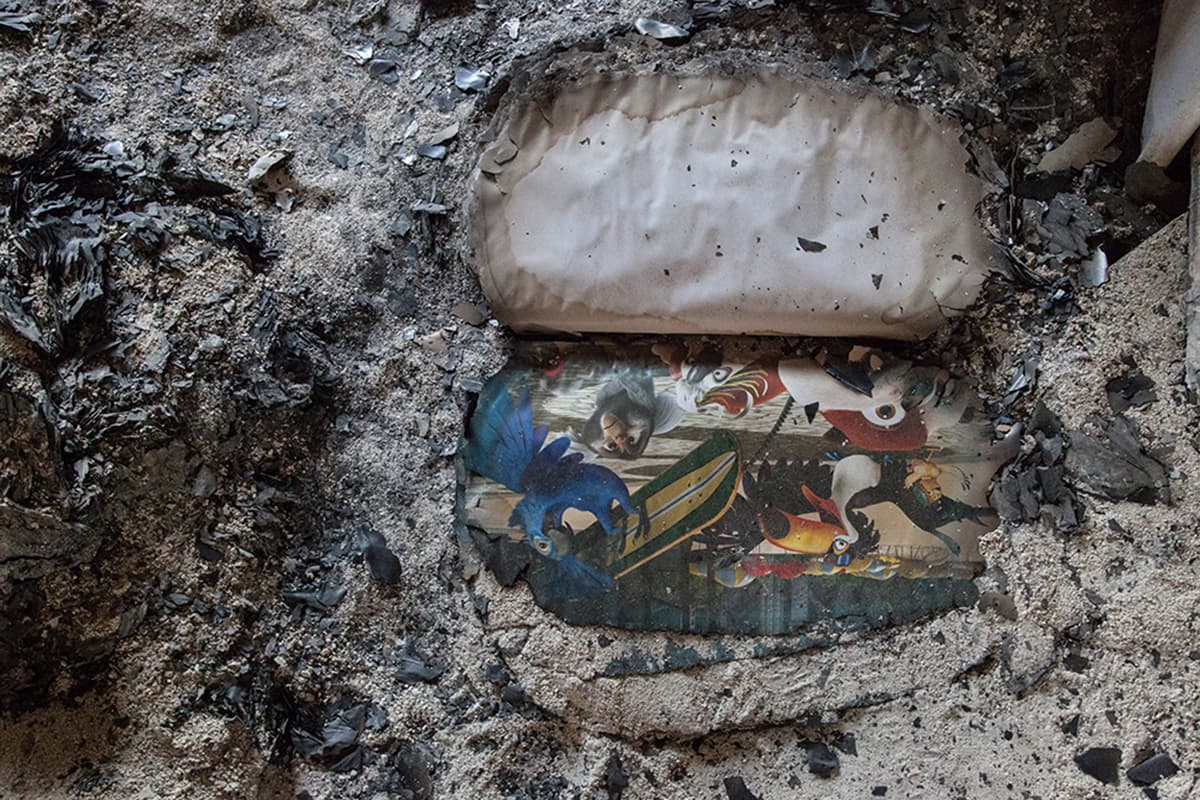 Burnt remains of animated film Rio can be seen amid the ashes. —Photo courtesy: Khaula Jamil
