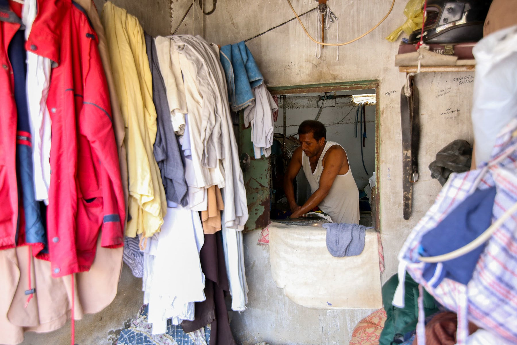 Handling a dryer, Miraj visits his shop twice a day.