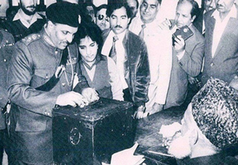 Zia casting his vote during the 1982 referendum that made him 'President.' Observers described the whole exercise as being 'an electoral farce'.