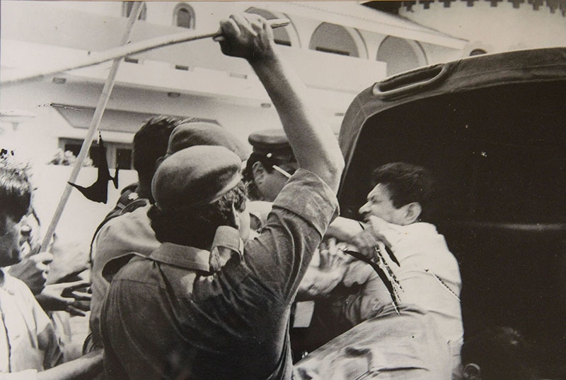Firebrand leftist leader, Miraj Mohammad Khan, being hauled up by the police during the 1983 MRD Movement in Karachi.