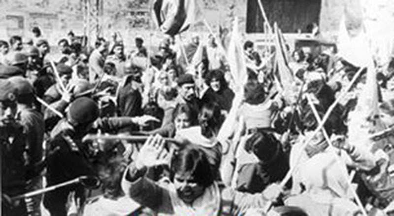 A riot breaks out as a women's rally is baton-charged by the police during the MRD Movement (1983).