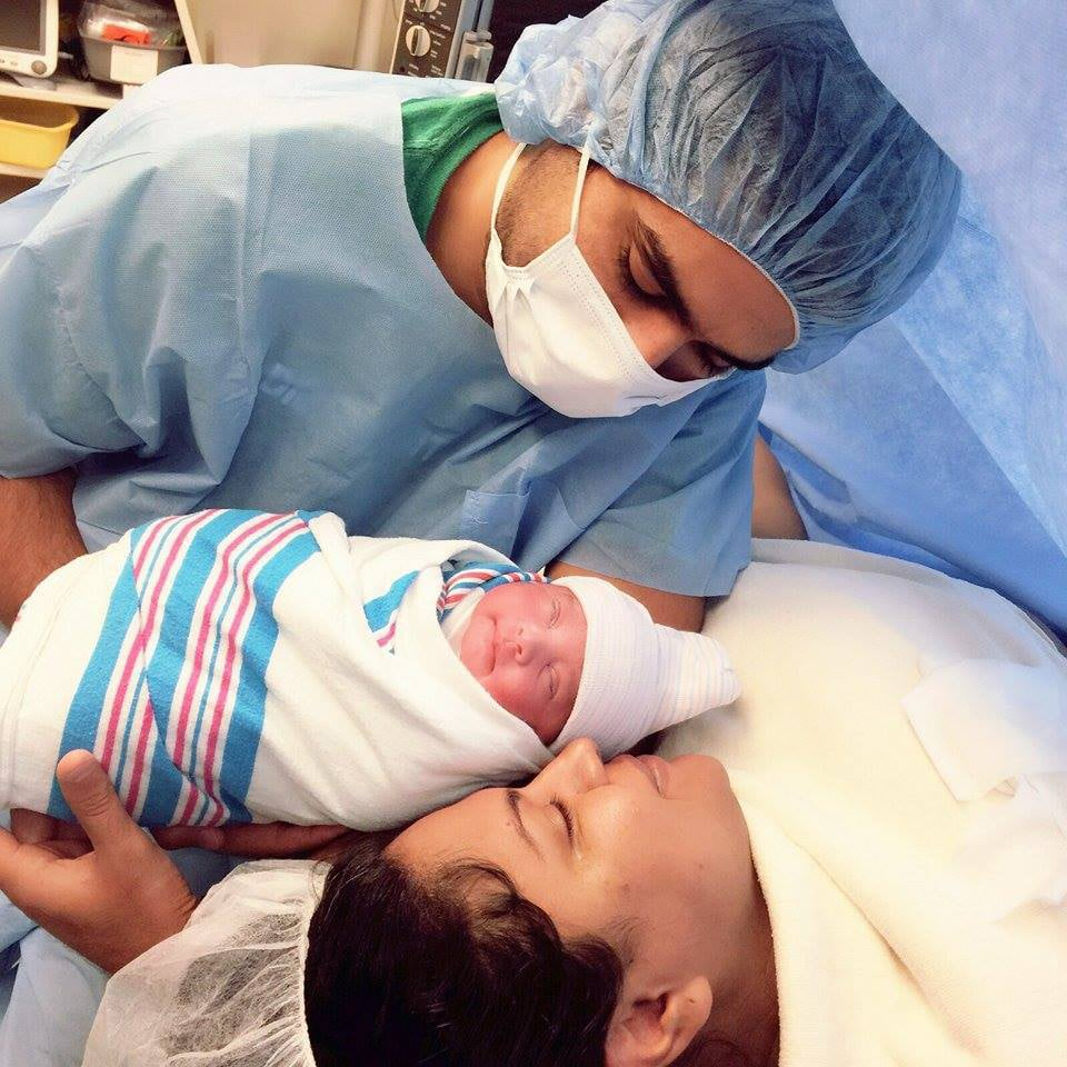 Veena malik and her husband asad khan with their baby