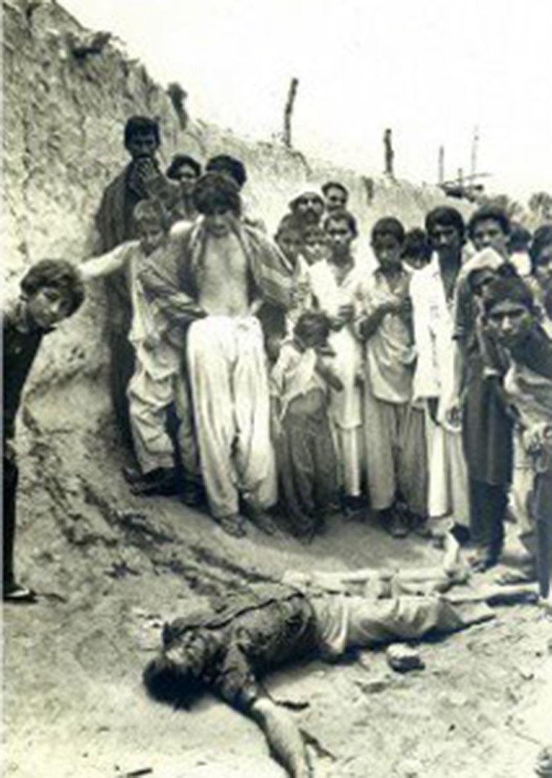 People gather around the body of an MRD activist in a village near Dadu (September, 1983).