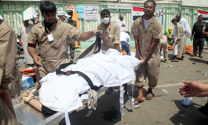 Saudi emergency personnel transport a body at the site where at least 450 were killed and hundreds wounded in a stampede in Mina. - AFP