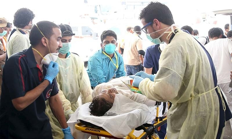 Medical personnel tend to a wounded pilgrim following a crush caused by large numbers of people pushing at Mina. - Reuters