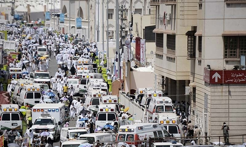 Saudi ambulances arrive with pilgrims who were injured in a stampede at an emergency hospital in Mina. - AFP