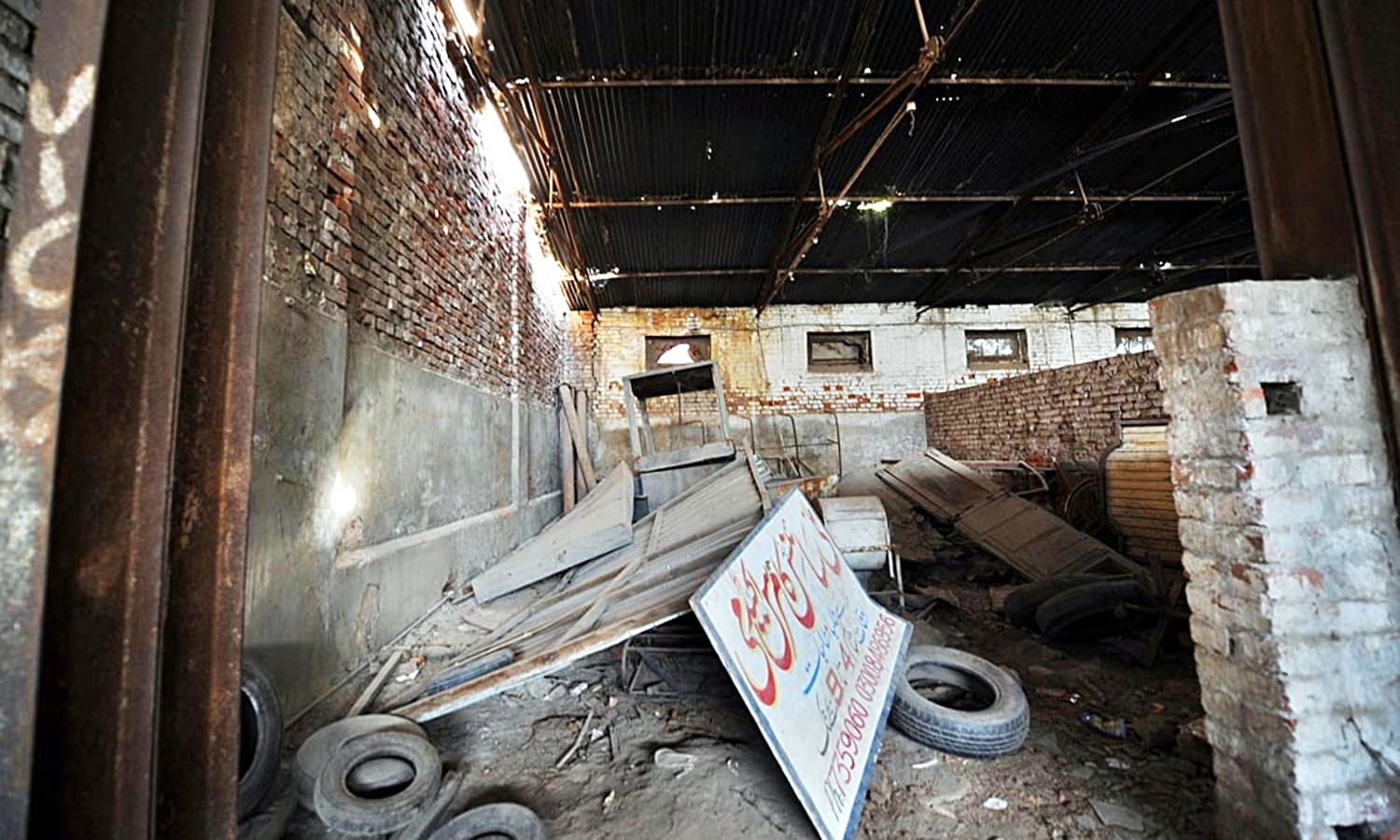 The terrible conditions and signs of deliberate damage all around the hall.