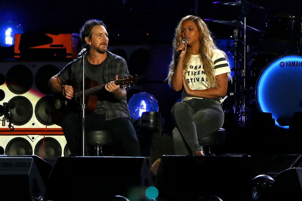 Eddie Vedder of Pearl Jam (L) and Beyonce perform at the Global Citizen Festival in Central Park on Saturday. — AP