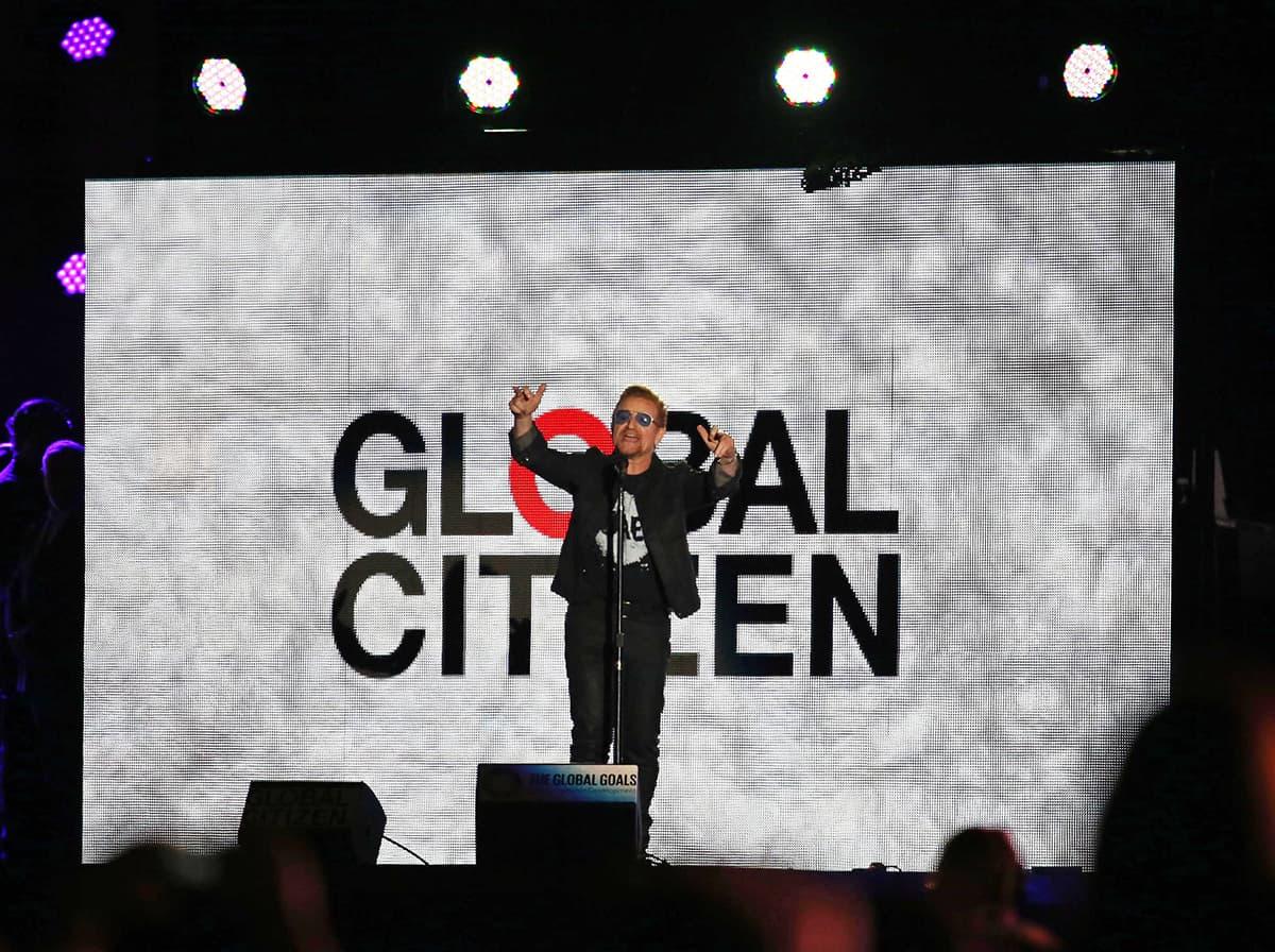 U2 lead singer Bono speaks at the Global Citizen Festival. — AP