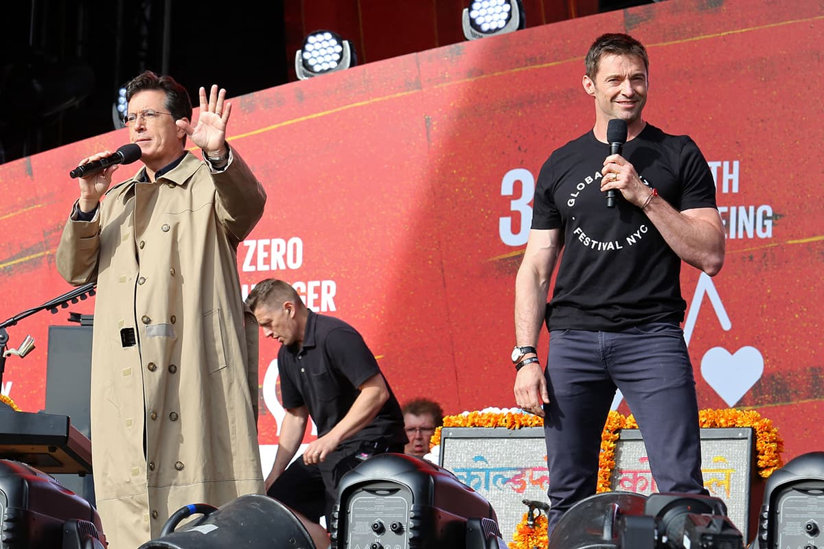 Stephen Colbert, left, and Hugh Jackman appear on stage at the Global Citizen Festival. — AP
