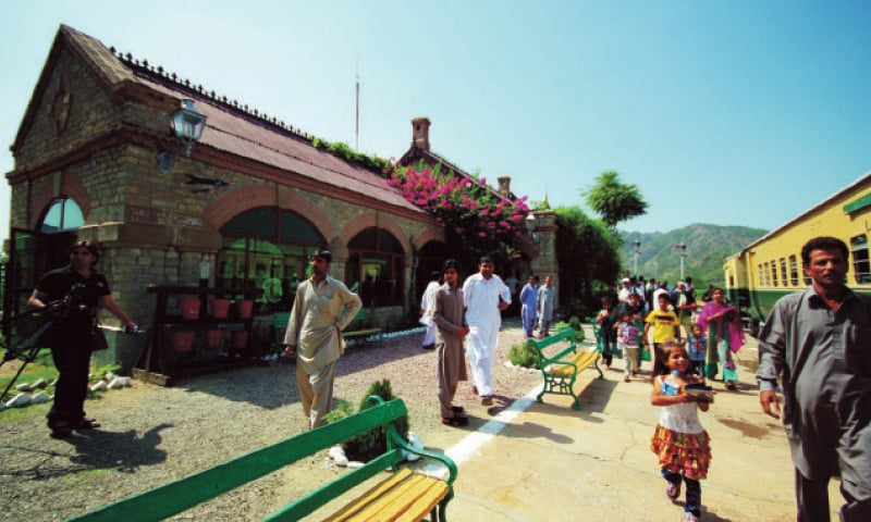 Tourists arrive at Attock Khurd railway station. — Dawn