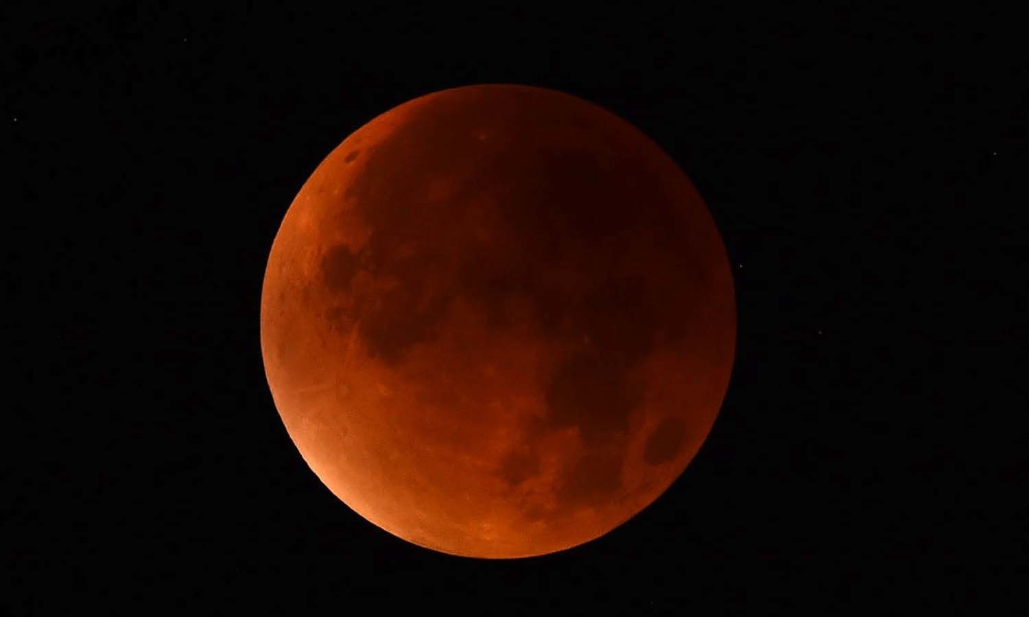 """A so-called """"blood moon"""" can be seen during a total lunar eclipse in Essen, western Germany. — AFP"""