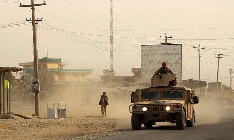 Afghan security forces travel in a Humvee vehicle, as battles were ongoing between Taliban militants and Afghan security forces, in Kunduz, capital of northeastern Kunduz province. —AFP