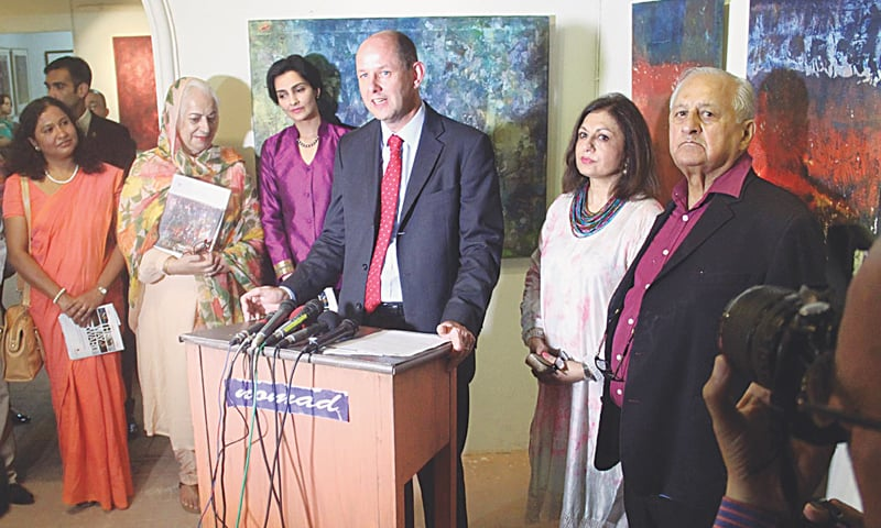 British High Commissioner for Pakistan Philip Barton speaks during the painting exhibition while PCB chairman Shaharyar Khan looks on. — INP