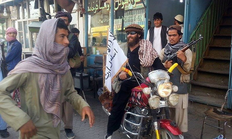 Taliban attack airport after seizing Afghan city, heavy fighting erupts
