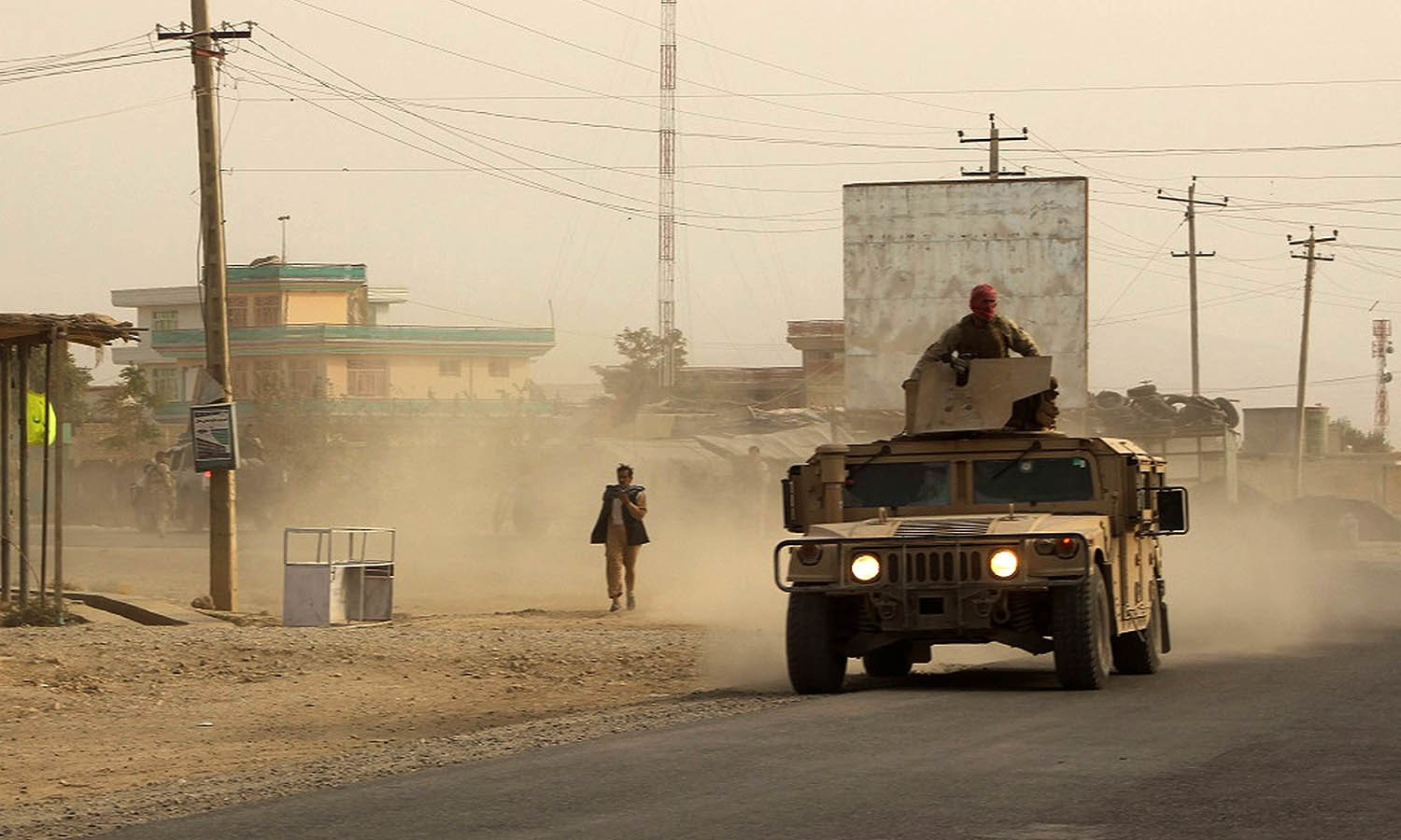Afghan security forces travel in a Humvee vehicle, as battles were ongoing between Taliban militants and Afghan security forces, in Kunduz, capital of northeastern Kunduz province. — AFP