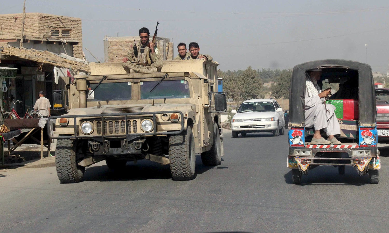 Afghan security forces travel on an armored vehicle in Kunduz Province, Afghanistan. — Reuters