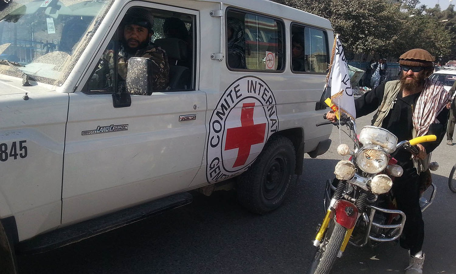 Taliban fighters are seen in an International Commitee of the Red Cross (ICRC) vehicle a day after the insurgents overran the strategic northern city of Kunduz. — AFP