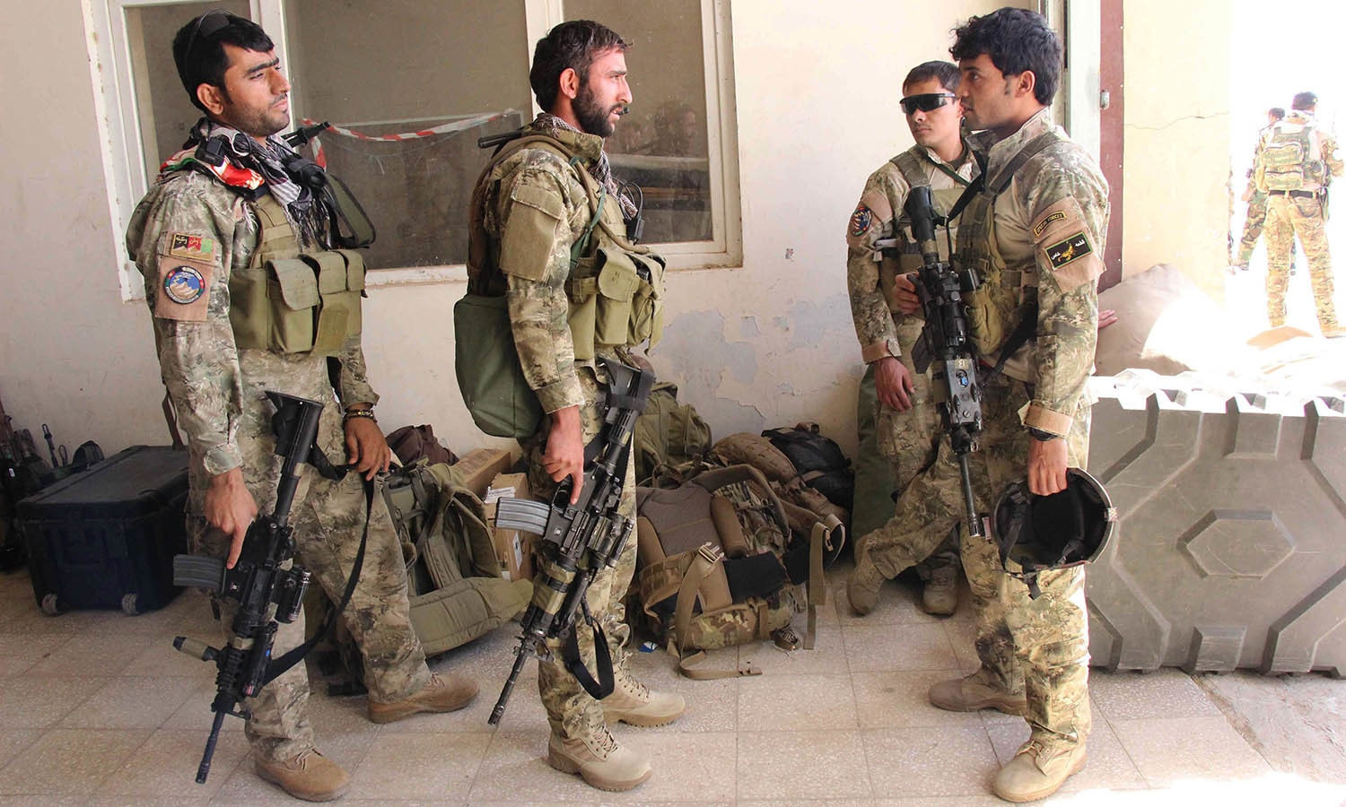Afghan special forces arrive at the airport as they launch a counteroffensive to retake the city from Taliban insurgents, in Kunduz. — AFP