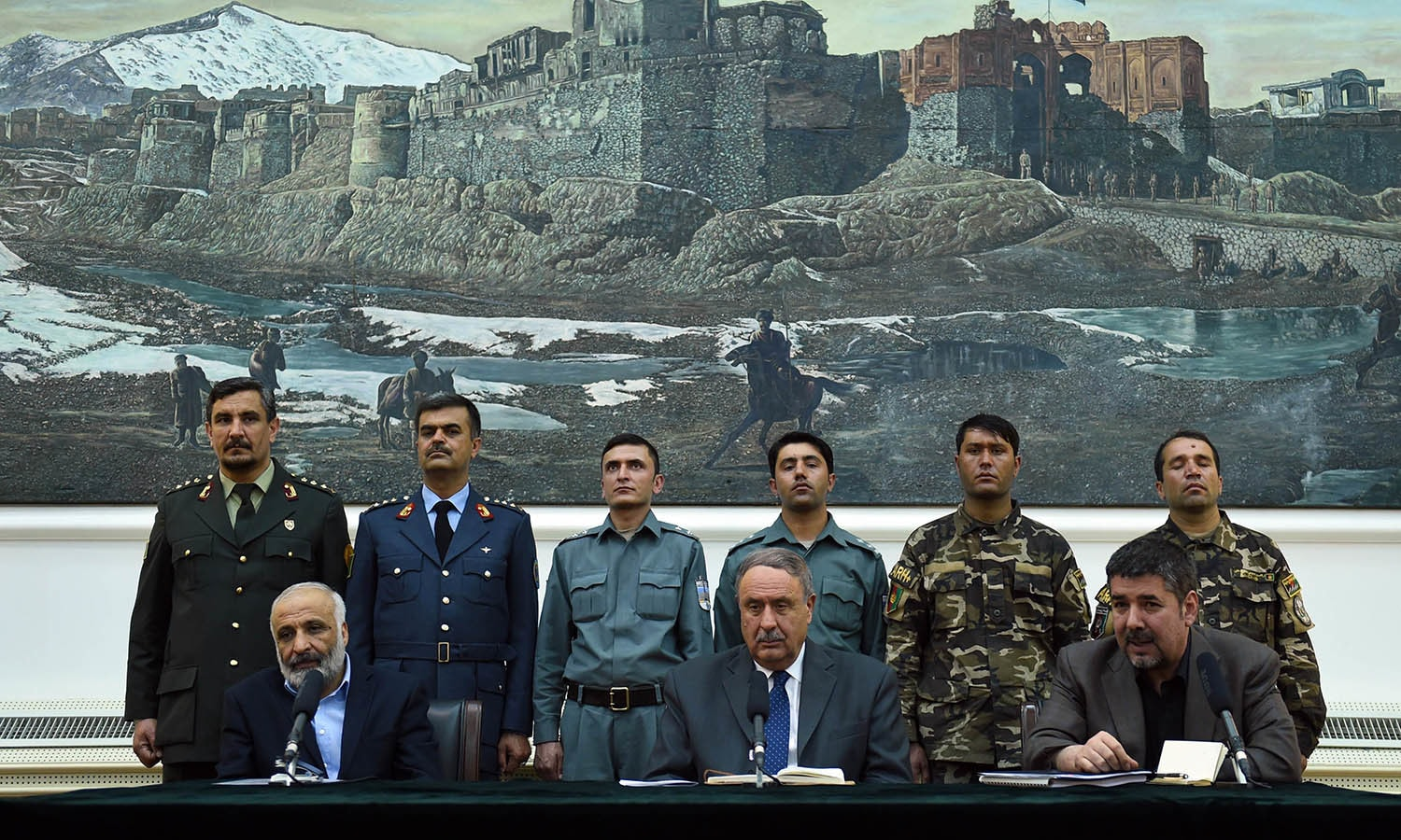 Afghan acting Defence Minister Mohammed Masoom Stanekza (L), Interior Minister General Nur ul-Haq Ulumi (C) and the Head of the National Directorate of Security (NDS) Rahmatullah Nabil (R) look on during a press conference at the presidential palace in Kabul. — AFP