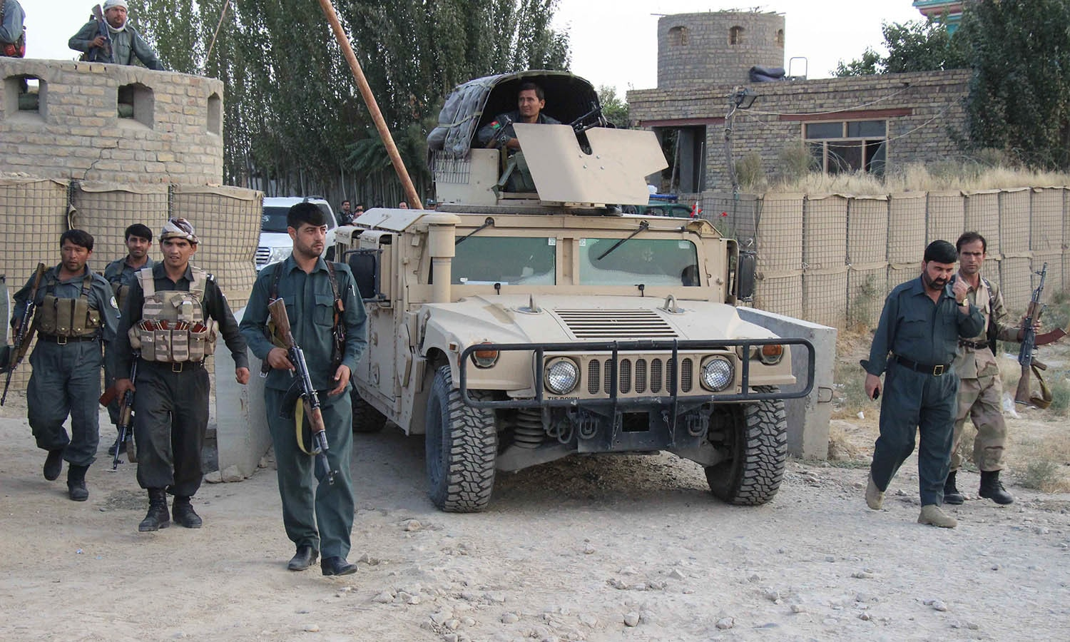 Afghan security personnel keeping watch as heavy fighting erupted near the airport on the outskirts of Kunduz. — AFP