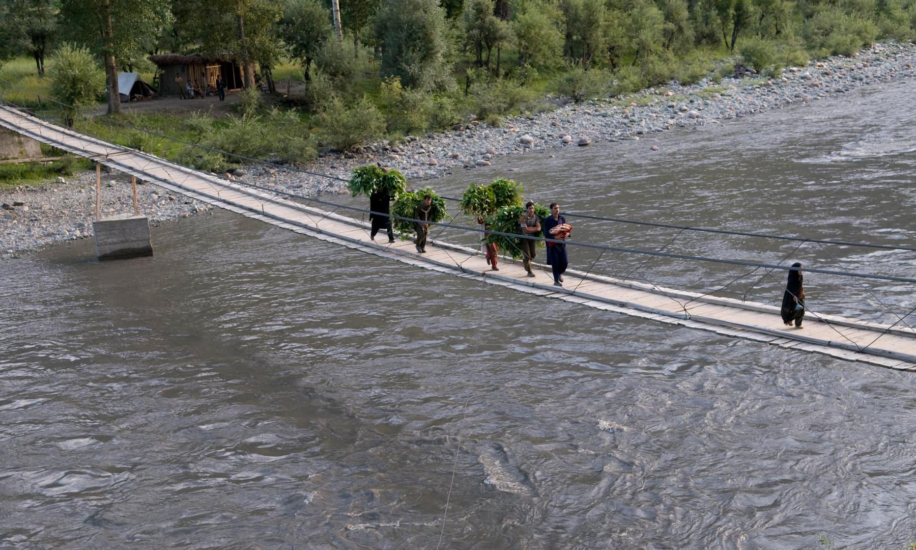 People cross the bridge over the Neelum River in Taobat | Tapu Javeri, White Star
