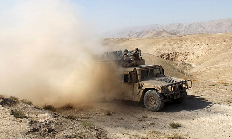 An Afghan security vehicle advances towards the city of Kunduz, Afghanistan. — Reuters