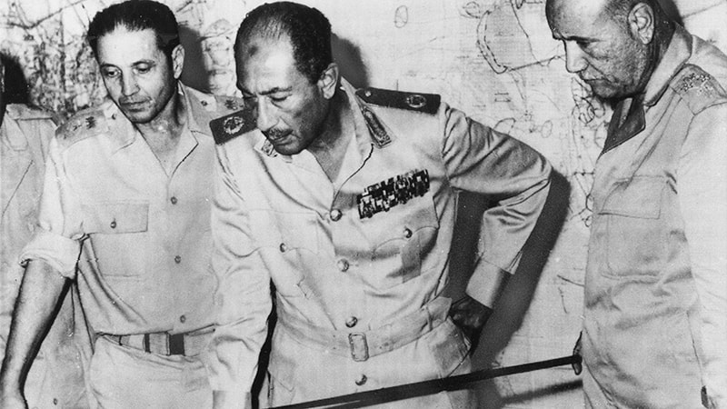 Sadat flanked by Egyptian officers during the 1973 Arab-Israel War.