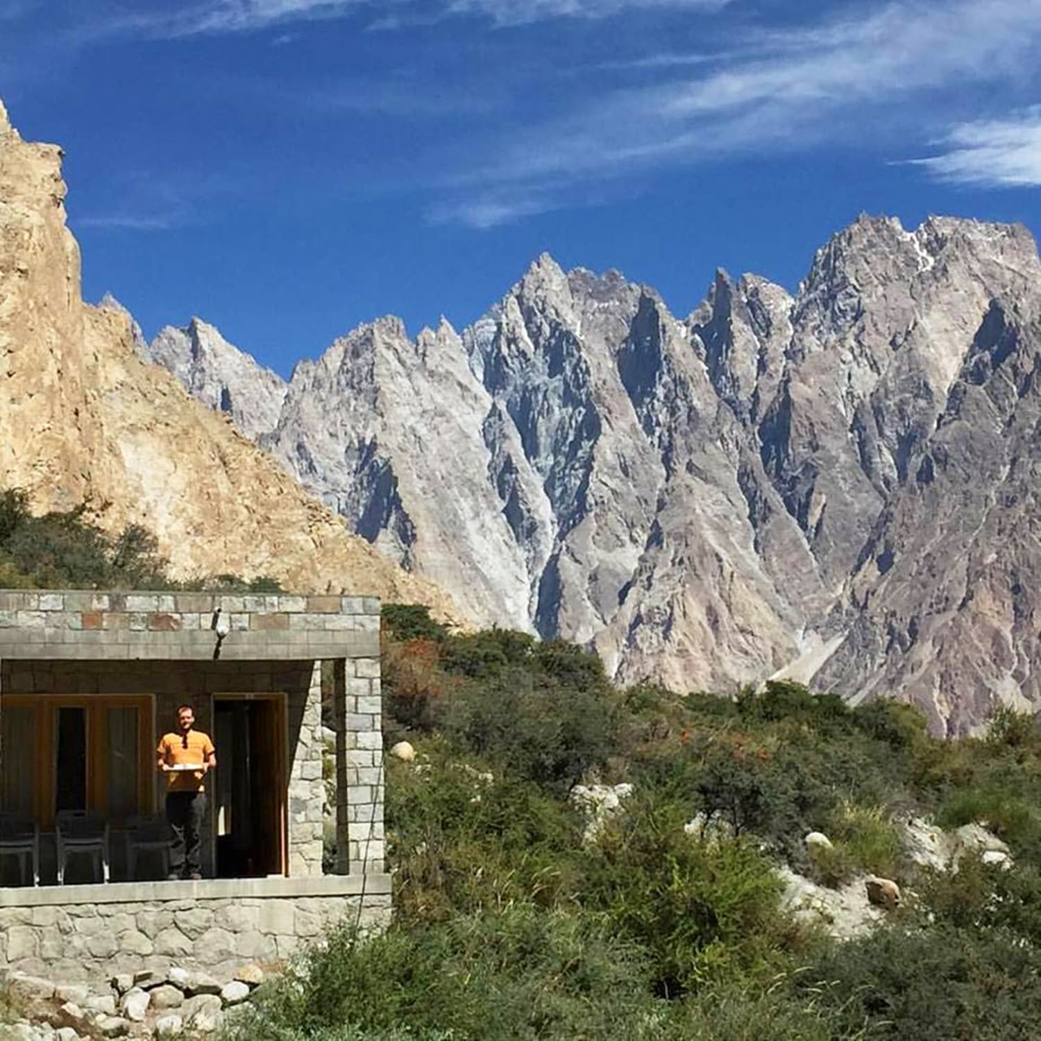 Holding the breakfast tray with the mighty Passu cones in the background. —Photo by Viviana Mazza.