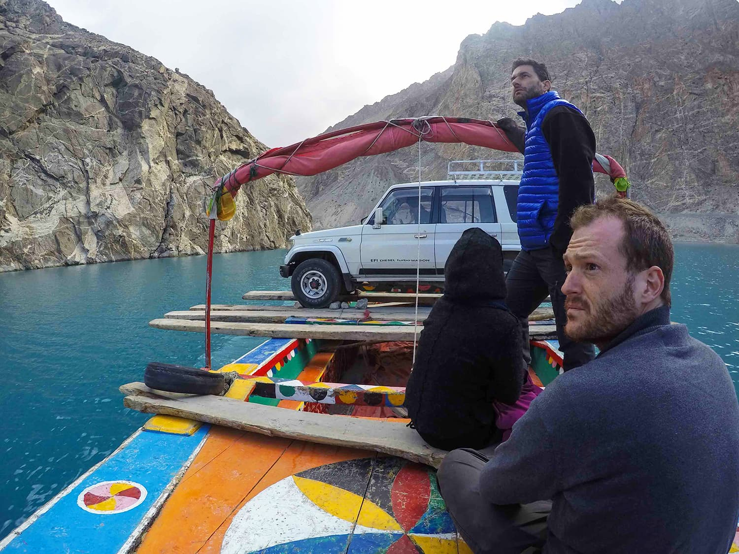 Scanning the mountains for ibexes while on the way back to Hunza on Attabad Lake. —Madeeha Syed