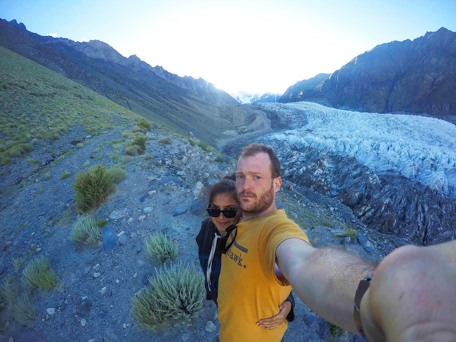 My friend Madeeha (read: bodyguard) and I against a sunset on the Passu Glacier. —Madeeha Syed