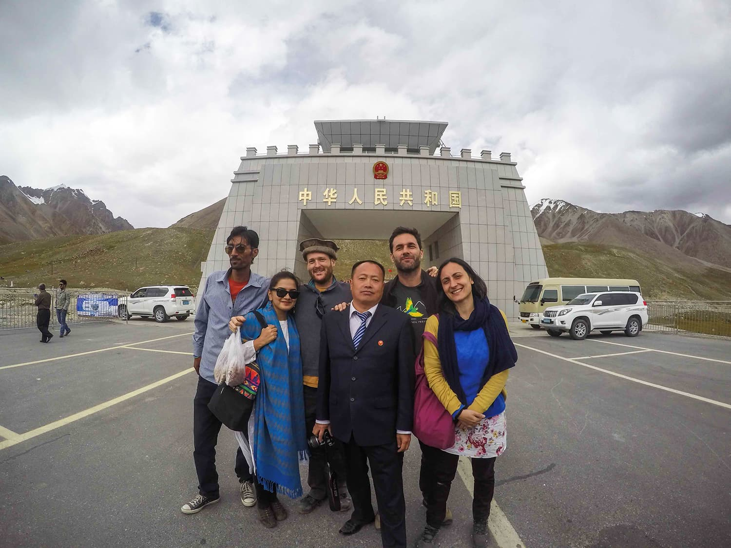 An Australian, American, Italian, Pakistani, their trusty driver and a random Chinese person pose at the Khunjerab Pass. Everywhere I went, people wanted to get their photos taken with me and then, of course, they would offer me chai. —Madeeha Syed
